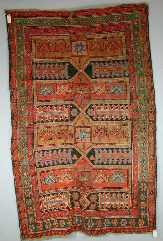 Anatolian village rug, probably west Anatolia second half 19th century, 6ft.6in. x 4ft.4in. 1.98m. x 1.32m. (Woolley & Wallis 9 July 2002)