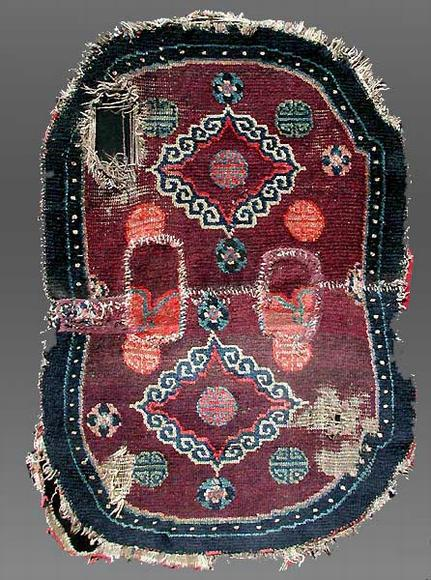An early example of Tibetan weaving. Featured in an exhibition at Adraskand, INC and reviewed by Murray Eiland Jr. in ORR, Eiland speculated this may be an 18 century saddle rug.