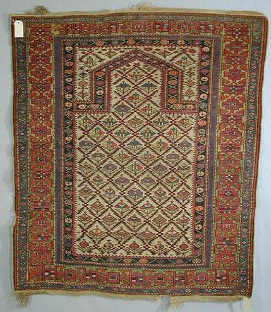 1130 - Woolley & Wallis, Eastern and Western Carpets and Rugs, Textiles and Needlework Sale, 11 February 2004
