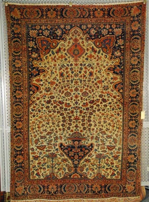 Lot 563, a Sarouk Fereghan rug 1910. 6 feet 2 inches x 4 feet 4 inches. Estimate $1,000-1,500