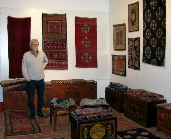 Antonio Chiari in his stand with Tibetan rugs