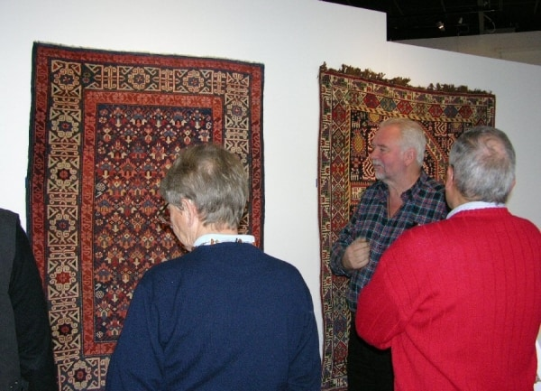 Sonny Berntsson, Gothenburg Rug Society – AKREP, showing Danish guests a Seichur Kuba at an exhibition of Caucasian rugs in Gothenburg in 2010.