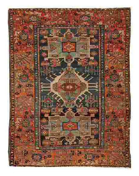Lot 62, a Karaja rug, North West Persia, circa 1910, 6 ft 5 in x 4 ft 9 in (195 x 145 cm). Estimate 600 – 800 GBP.
