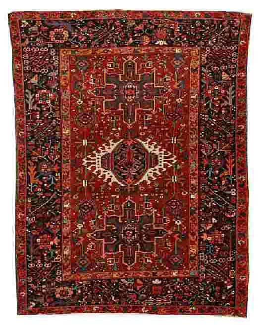 Lot 90, a Karaja rug, North West Persia, circa 1910, 6 ft 3 in x 4 ft 8 in (190 x 142 cm). Estimate 400 – 600 GBP.