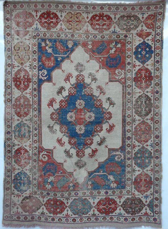 White ground Transylvanian medallion rug 17th century. Size 1.70m x 1.26m. Exhibitor Aaron Nejad.