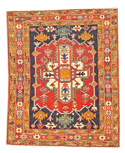Lot 6124, a Serapi rug Northwest Persia size approximately 3ft. 8in. x 4ft. 5in. Estimate: $3,500 – 4,500