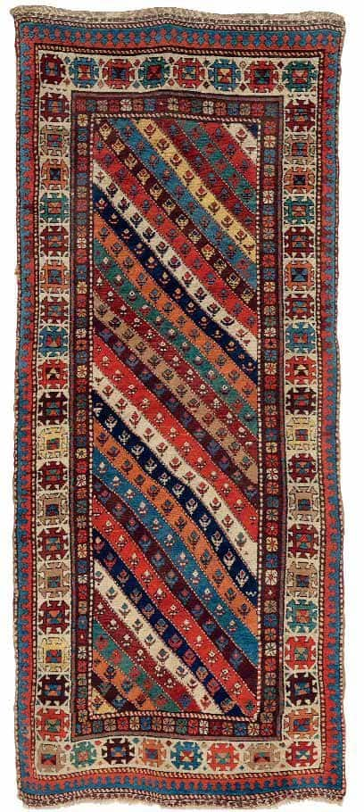 Lot 553, A SHASAVAN LONG RUG, NORTHWEST PERSIA, CIRCA 1880. Estimate 6.000 – 8.000