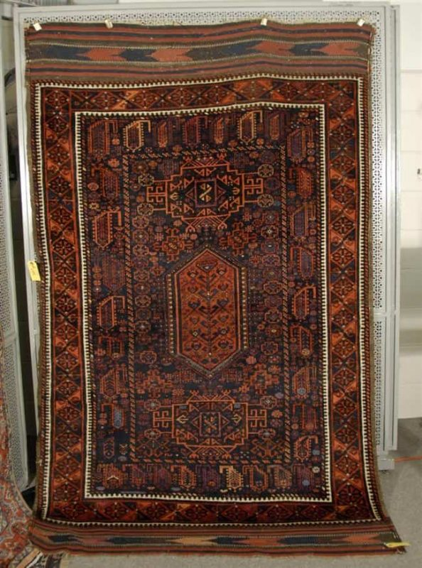 Lot 1004. BELOUCH RUG, Afghanistan, circa 1900; 7 feet 2 inches x 4 feet 6 inches Estimate $1,500-2,000