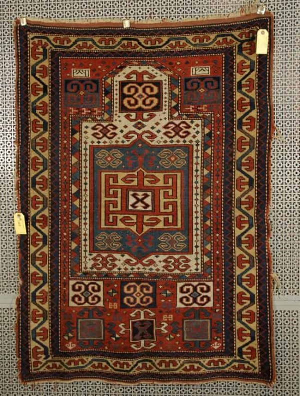 Lot 1007. KAZAK PRAYER RUG, Caucasus, late 19th century, dated; 4 feet 5 inches x 3 feet 1 inches Estimate $800-1,200