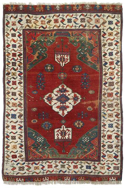Lot 14. Double niche rug with central medallion and lappets at both ends, Ushak area, West Anatolia, 17th ct. or earlier. 225×150 cm. Estimate 20,000 EUR