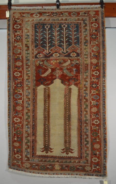 Lot 1913. A Ladik prayer rug, central Anatolia, early to mid 19th century, 5ft. 8in. x 3ft. 4in. 1.73m. x 0.89m. £300-500
