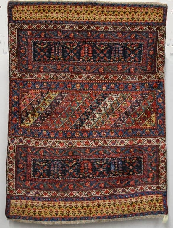 Lot 2039. A Kurdish piled mafrash, north west Persia, late 19th/early 20th century, overall 5ft. 4in. x 3ft. 11in., 1.63m. x 1.20m. £600-800