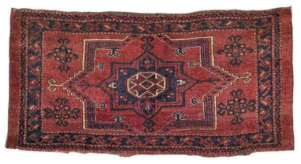 Lot 38. Ersari torba face with one medallion and four Kochak-ornaments, Turkmenistan, circa 1900. Size 52 x 110 cm. Estimate 400 EUR. From the Collection of Dr. Werner Loges