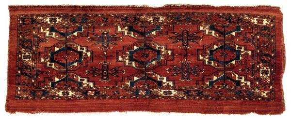 Lot 24, a Tekke Torba. Dimensions: 44 x 113 cm Age: First half 19th century Estimate: 3,600.00 €