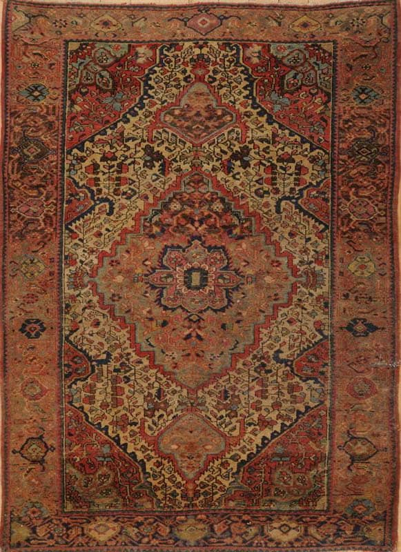 Lot 551, a Feraghan medaillions rug 4 ft. 9 in. x 3 ft. 3 1/2 in. Estimate 400-600$