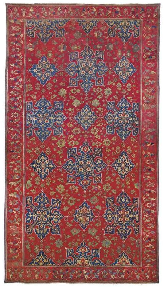 A LARGE STAR USHAK CARPET WEST ANATOLIA, FIRST HALF 16TH CENTURY Est. £80,000 – £120,000