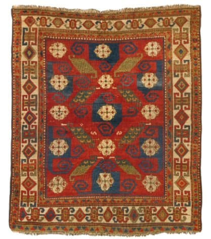 Lot 7. A KAZAK PINWHEEL RUG, SOUTHWEST CAUCASUS Estimate: 25,000 - 35,000 USD approximately 6ft. 7in. by 5ft. 10in. (2.01 by 1.78m.) circa 1880