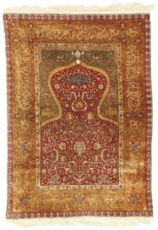 "Lot 144. AN AVEDIS TAMISHJIAN KUM KAPI SILK AND METAL THREAD PRAYER RUG, ISTANBUL, NORTHWEST ANATOLIA Estimate: 40,000 – 60,000 USD ""Avedis Tamishjian"" Kufic signature in central metal thread palmette approximately 4ft. 2in. by 2ft. 11in. (1.27 by 0.89m.) circa 1920. (Sothebys 26 October 2012)"
