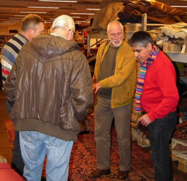 "Aram Safaei (right) in ""rug talk"" with members of the Danish Rug Society"