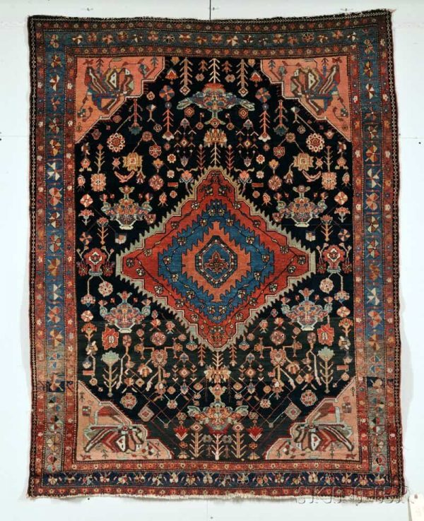 Lot 12, a Senneh Rug, Northwest Persia, late 19th/ early 20th century, 6 ft. 6 in. x 5 ft. Estimate: $2500 – 3500