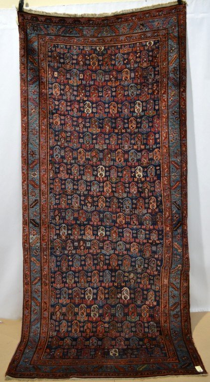 Lot 2103. A Bakhshaish long rug, north west Persia, early 20th century, 3.17m. x 1.42m. Estimate £1200-1500
