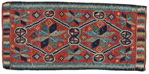 Lot 305. CARRIAGE CUSHION. Rölakan (flat weave). 49,5 x 106 cm. Skåne first half of the 19th century. Estimate € 700 – 950