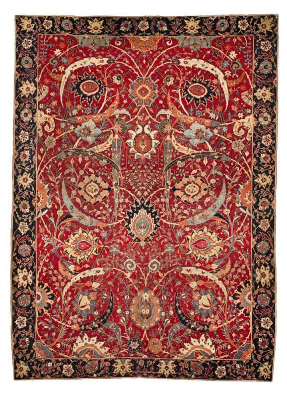 The Clark 'sickle-leaf,' vine scroll and palmette carpet, probably Kirman, Southeast Persia, 17th century. Size approximately 8ft. 9in. by 6ft. 5in. (2.67 by 1.96m.). Estimate $5,000,000 – 7,000,000
