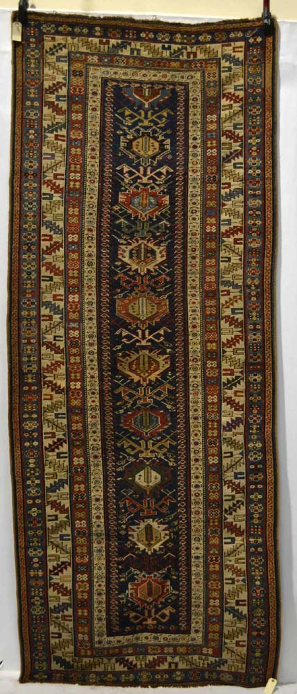 Lot 2001. Genje long rug, south east Caucasus, third quarter 19th century, 8ft. 11in. x 3ft. 6in. 2.72m. x 1.07m. £1500-2000