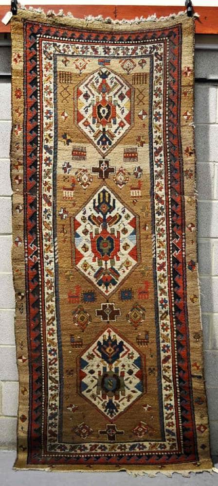 Lot 1615: Sarab long rug early 20thC. 8ft. 11in. x 3ft. 9in. 2.72m. x 1.14m. Estimate £300-500