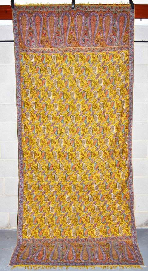 Lot 1834. Yellow field Kashmir long shawl, mid-late 19thC 124in. x 55in. 315cm. x 140cm. Estimate: £2,000-3,000