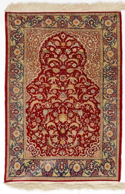 A signed full silk Hereke rug, Turkey. Niche design. C. 1.6 mio. kn. pr. sqm. Second half of the 20th century. 20. årh.s anden halvdel. 95 x 65 cm. (Bruun Rasmussen February 2014)
