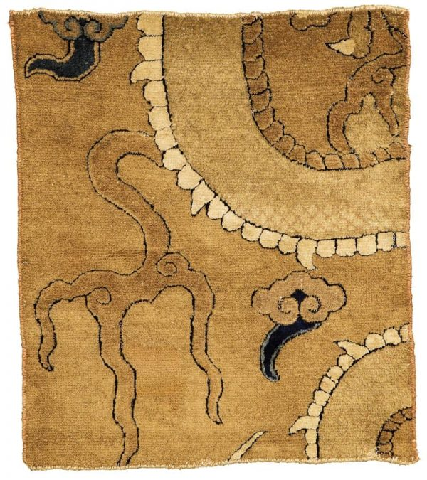 From the Estate of Eva Louise Woodhead Feuerstein. A Chinese dragon carpet fragment, Ming Dynasty, 16th century. Approximately 84 x 74 cm. $7,000-10,000