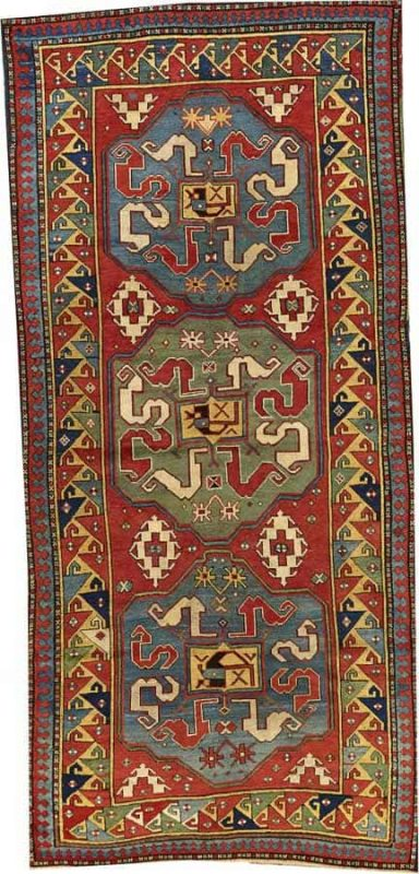 Lot 2067. A CLOUDBAND KAZAK RUG Caucasus size approximately 4ft. 3in. x 9ft. 1in. US$ 4,000 - 6,000