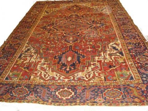 Lot 232. A HERIZ CARPET, North West Persia, 372cm x 253cm. £600 - 800