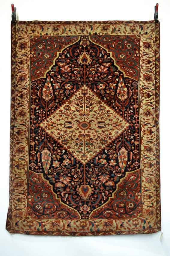 Lot 1535, a Sarouk rug, north west Persia, late 19th century, 6ft. 7in. x 4ft. 8in. 2.01m. x 1.42m. Estimate: £1000-1500