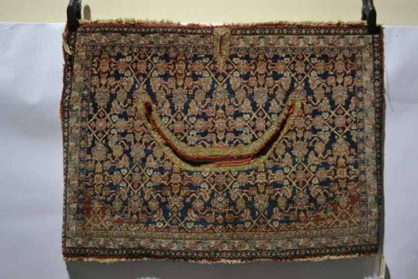 Lot 430. North west Persian saddle cover, about 1920-30s, 2ft. 5in. x 3ft. 4in. 0.74m. x 1.02m. Estimate £600-700
