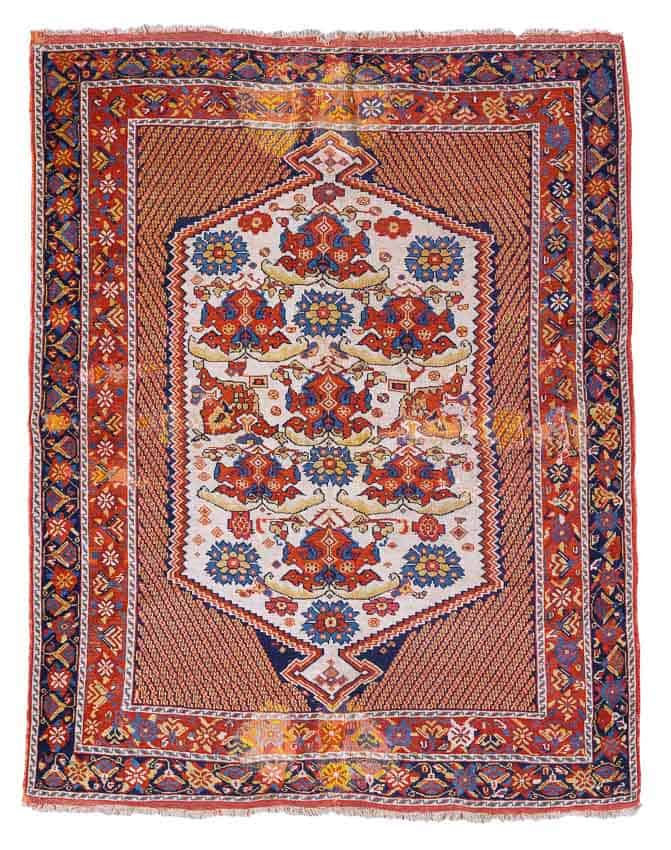LOT 186, AN AFSHAR RUG, SOUTH EAST PERSIA approximately 172 by 137cm; 5ft. 7in., 4ft. 6in. late 19th century. Estimate 2,000 — 4,000