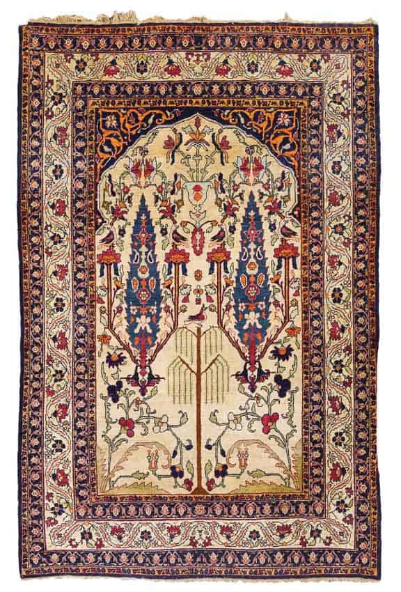 LOT 187, A KIRMAN LAVER PRAYER RUG, SOUTH EAST PERSIA approximately 212 by 134cm; 6ft. 11in., 4ft. 4in.circa 1900. Estimate 3,000 — 4,000 GBP