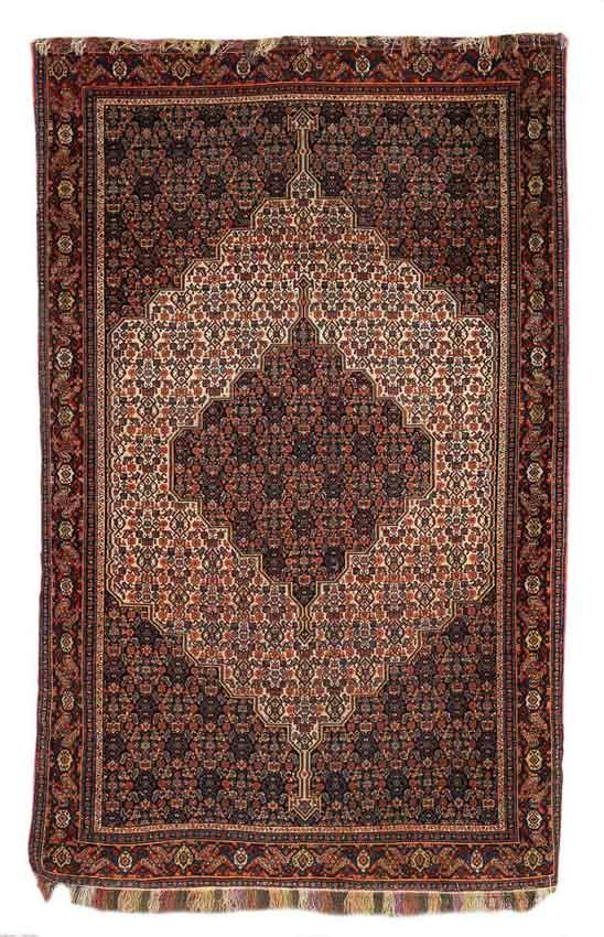 Lot 253, A SENNEH RUG, West Persia, circa 1880, 206 x 133 cm. Estimate £5,000 - 7,000