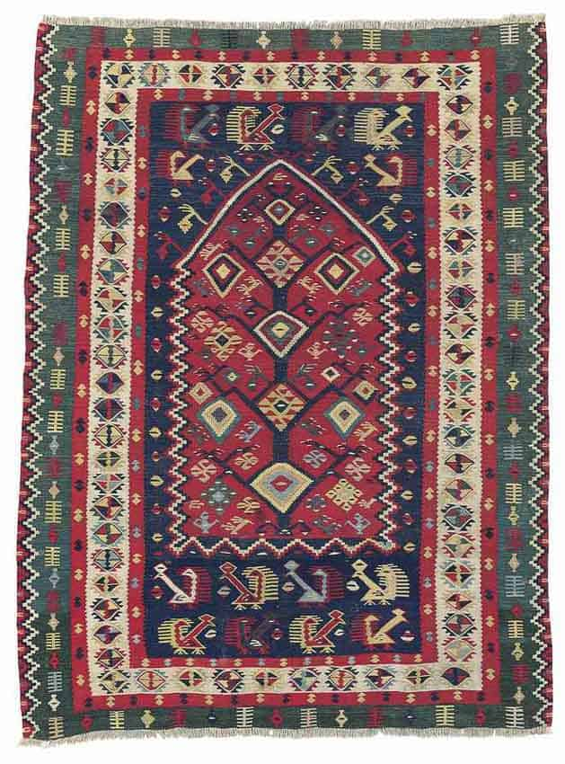 Lot 4, a Sarkoy kilim prayer rug, West Anatolia late 19th century. Size 6ft.10in. x 4ft.2in. (208cm. x 127cm.) Estimate £5,000 – £7,000