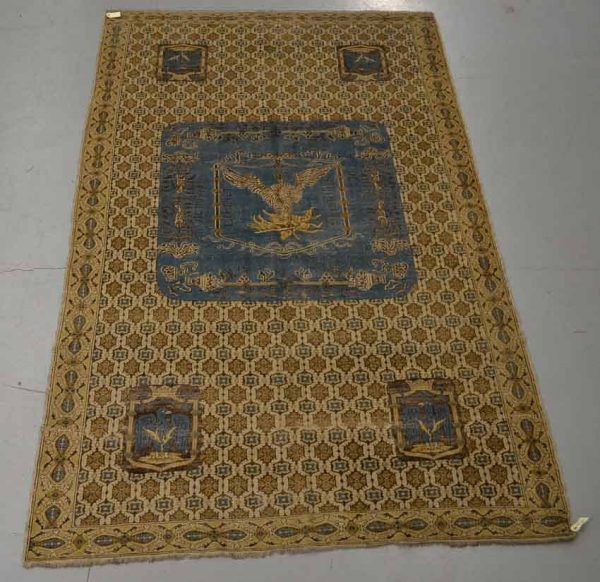 Lot 232. Armorial carpet of classical Spanish design, believed to be from the workshop of Theodor Tuduc, Romania, second quarter 20th century, 9ft. 2in. x 5ft. 8in. 2.80m. x 1.73m. £5,000-7,000