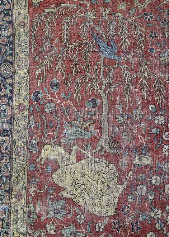 Detail of lot 49. A Moghul animal carpet.