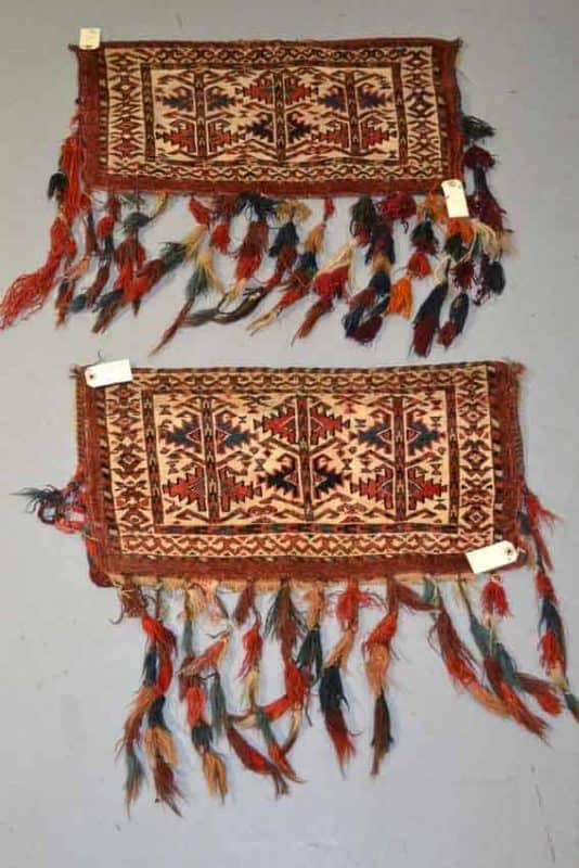 Lot 337. Pair of rare white ground Yomut Turkmen mafrash faces, Turkmenistan, second half 19th century, each 1ft. 2in. x 2ft. 3in. 0.36m. x 0.69m. £1700-2000