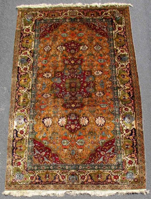Lot 517. Hereke silk rug circa 1910.