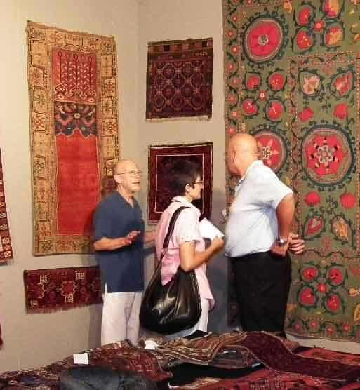 Michael Craycraft and visiting collectors in the stand of Galerie Arabesque, Sartirana Textile Show 2011