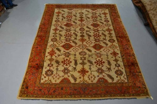 Lot 191 - Ushak ivory field carpet, west Anatolia, early 20th century, 11ft. 11in. x 8ft. 10in. 3.63m. Estimate 800 GBP - 1,200 GBP