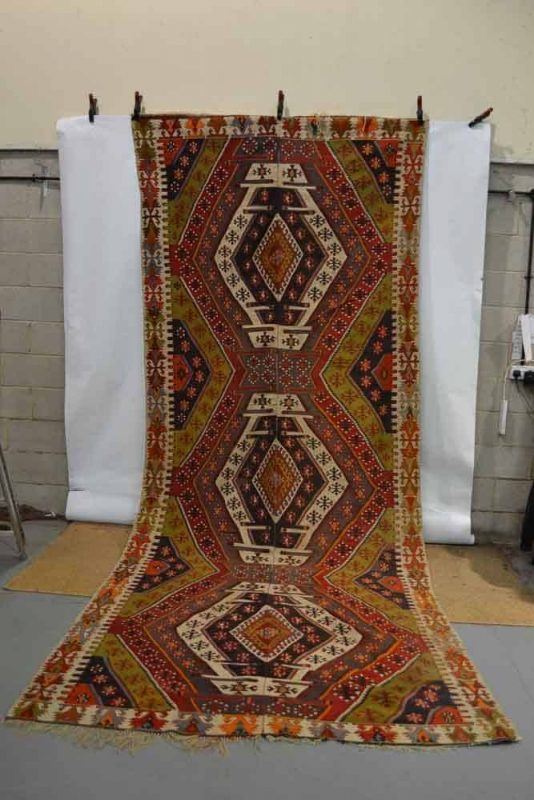 Lot 297 - Rashwan kelim, Malatya area, central Anatolia, circa 1920s-30s, 14ft. 8in. x 6ft. 1in. Estimate: 300 GBP - 500 GBP