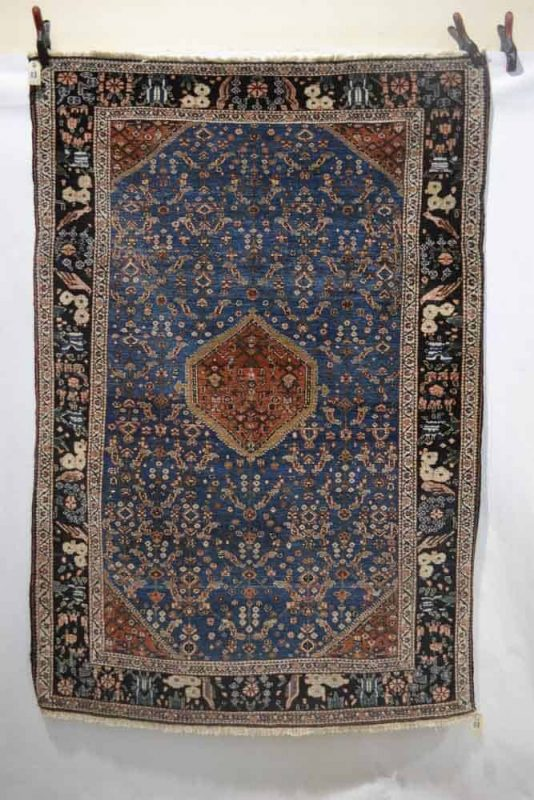 Lot 450 - Rug by the Kashkuli taifeh of the Qashqai Confederation, Fars, south west Persia, circa 1920s. Estimate: 600 GBP - 800 GBP