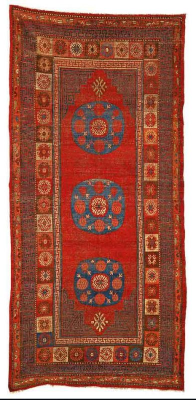 Lot 105. A Khotan carpet, East Turkestan, approximately 12ft. 7in. by 5ft. 11in. (3.84 by 1.80m.), circa 1800. Estimate  15,000 — 20,000  USD