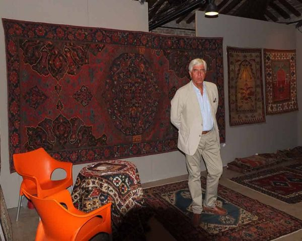 Franco Dell'Orto in front of a late 16th century Ushak carpet